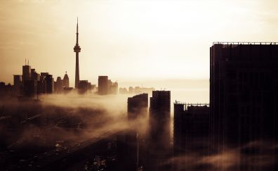 Toronto city's CN tower, sunrise, mist