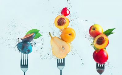 Fruits, water splashes, fork